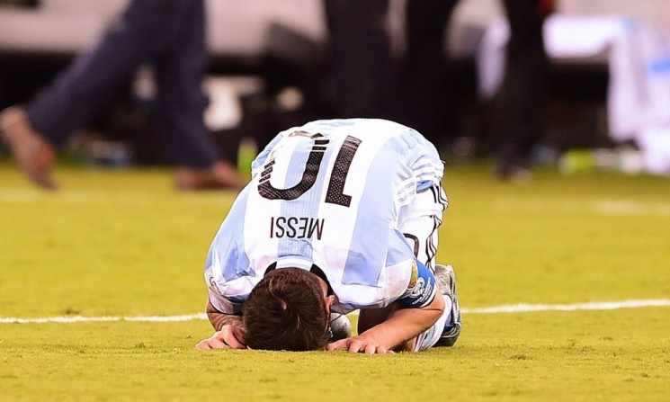 Argentina's Lionel Messi gestures after being defeated by Chile in the penalty shoot-out of the Copa America Centenario final in East Rutherford, New Jersey, United States, on June 26, 2016.  / AFP PHOTO / ALFREDO ESTRELLAALFREDO ESTRELLA/AFP/Getty Images